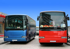 Bus waiting for tourists. Red and blue buses waiting for tourists Stock Photo
