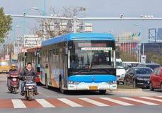 Bus waiting at traffic light, Yiwu, China Stock Images