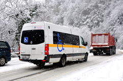 Bus for wheelchair driving in a snowstorm Stock Photography