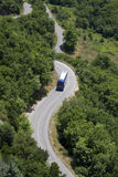 Bus on winding road  Royalty Free Stock Images