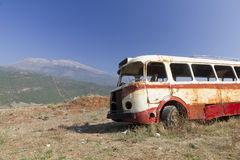 Bus wreck in arid landscape Stock Images