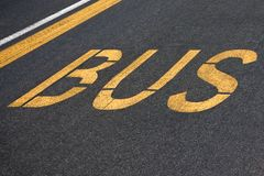 Bus written on asphalt Royalty Free Stock Images