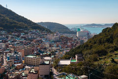 Busan Gamcheon Culture Village. Colorful and lovely village in South Korea with green mountain and clear blue sky as background stock image