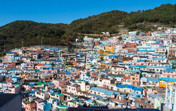 Busan Gamcheon Culture Village. Colorful and lovely village in South Korea with green mountain and clear blue sky as background royalty free stock images