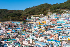 Busan Gamcheon Culture Village. Colorful and lovely village in South Korea with green mountain and clear blue sky as background royalty free stock image