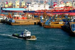 Busan Industrial Harbor. A working tug back dropped by moored barges and the shipbuilding yards in Busan, South Korea. South Korea accounted for 50% of all the royalty free stock photos