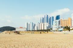 Haeundae beach and modern building in Korea. Busan, Korea - January 6, 2015 : Haeundae beach and modern building in Busan, Korea Stock Image