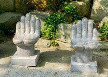 Ancient white stone hand shaped chairs stand in Haedong Yonggungsa, Chinese buddhism temple in Busan, South Korea. royalty free stock images