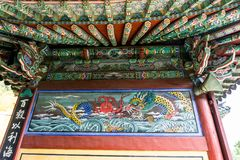 Beautiful old wall painting of Sea dragon fighting with giant Kraken stock image
