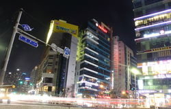 Busan, South Korea - March 26th of 2015: Night view of several buildings and main road in front of the beach. Stock Photography