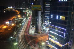 Busan, South Korea - March 26th of 2015: Night view of several buildings and main road in front of the beach. Stock Photos