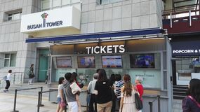 Busan Tower ticket office. Busan, South Korea - September 8, 2017: Tourists line up at Busan Tower ticket office to purchase tickets for tower observatory Royalty Free Stock Photo