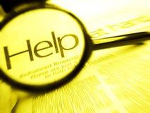Busca para a ajuda da palavra com magnifier Fotografia de Stock Royalty Free