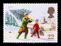 Buscando a árvore de Natal, serie 1990 do Natal, cerca de 1990 foto de stock