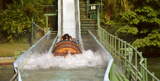 Busch Gardens Tampa Stanley Falls. Busch Gardens, Tampa, Florida, USA - October 27, 2016: Tourists on Stanley Falls log flume in Busch Gardens Tampa Royalty Free Stock Image