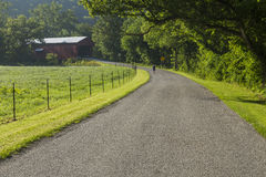 Busching Covered Bridge. A narrow road leading to a covered bridge Royalty Free Stock Image