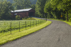Busching Covered Bridge. A narrow road leading to a covered bridge Royalty Free Stock Photos