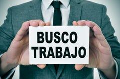 Busco trabajo som söker efter ett jobb i spanjor Arkivfoton