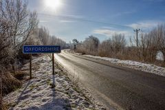 Buscot Lock in Winter Snow. BUSCOT, UNITED KINGDOM - FEBRUARY 03: Heavy snowfall overnight in the UK pictured alongside roads near the River Thames on February stock photo