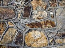 Buse för stenvägg som är strukrury i beigea signaler Royaltyfria Foton