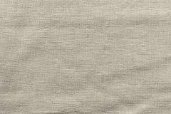 Buse vävt texturtyg av beige färg Arkivbilder