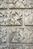 Busen texturerade murbrukväggbeläggningen, efterföljd av stenmurverket Abstrakt grå patchy bakgrund Arkivbilder