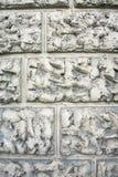 Busen texturerade murbrukväggbeläggningen, efterföljd av stenmurverket Abstrakt grå patchy bakgrund Arkivfoto