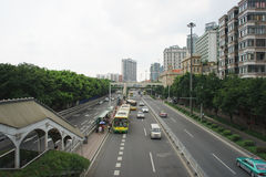 Buses and cars at roads of Guangzhou Stock Photo