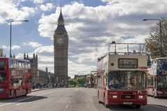 Buses cross Westminster Bridge in London Stock Photo