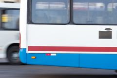 Detail of moving buses in blue, red and white colors royalty free stock photography