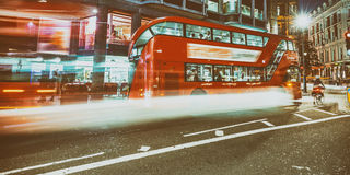 Buses in London with light trails at night Stock Photo