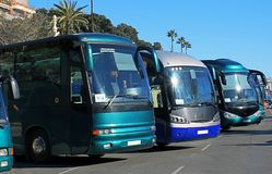 Buses in a parking. Close up view of different buses in a parking royalty free stock photography