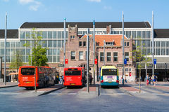 Buses and station building in Haarlem, Netherlands Stock Photo