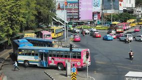 Buses stopped at one of the city`s main bus stations. Bangkok - January 9, 2018: Smooth-flowing traffic and buses stopped at one of the city`s main bus stations stock footage