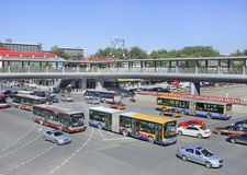 Buses and taxis on a busy intersection, Beijing, China Stock Images