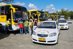 Buses and taxis in a row at the Tagbak Bus Terminal stock image
