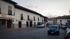 Buses In Town Square In South America. Bus drives through town square at sunset stock footage