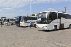 Buses for the transportation of passengers following a single ticket in the parking lot in the port of Crimea Stock Image