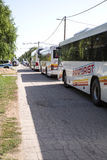 Buses wait to transport the arriving Refugees further in Tovarni Royalty Free Stock Photos