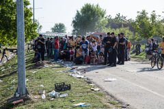 Buses wait to transport the arriving Refugees further in Tovarni Royalty Free Stock Images