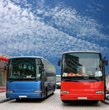 Buses waiting for passenger. Red and blue tour buses waiting for passenger Royalty Free Stock Photos