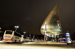 Buses at of ZOB Bus Port Hamburg in Germany. Modern architecture of a bus station in Hamburg, Germany, in night. Different brands of buses are parked at bus Royalty Free Stock Photography