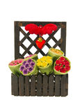 Bush of different color of roses and heart symbol in the wooden fence Stock Photos