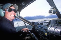 A bush pilot in a scout plane in Alaska Stock Images
