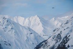 Bush Plane Flies Over Rainbow Glacier in Alaska royalty free stock photography