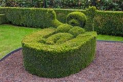 Bush sculpture in park - Durbuy Belgium. Nature background royalty free stock image