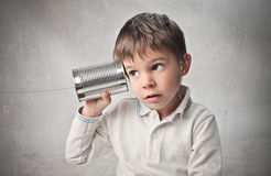 Bush telephone. Child using a can as a telephone Royalty Free Stock Photos