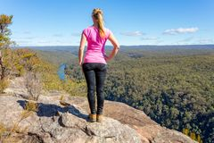 Bush walker admiring views high above the river Stock Photo