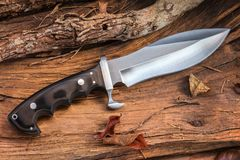 Knife buschcraft for survival, adventure and wilderness life. Bushcraft and survival big knife for camping and outdoor life. This kind of knife is better for Stock Image