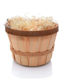 Bushel basket with wood handle. Bushel basket with a wood handle and stuffed with straw over a white background and slight reflection stock photography